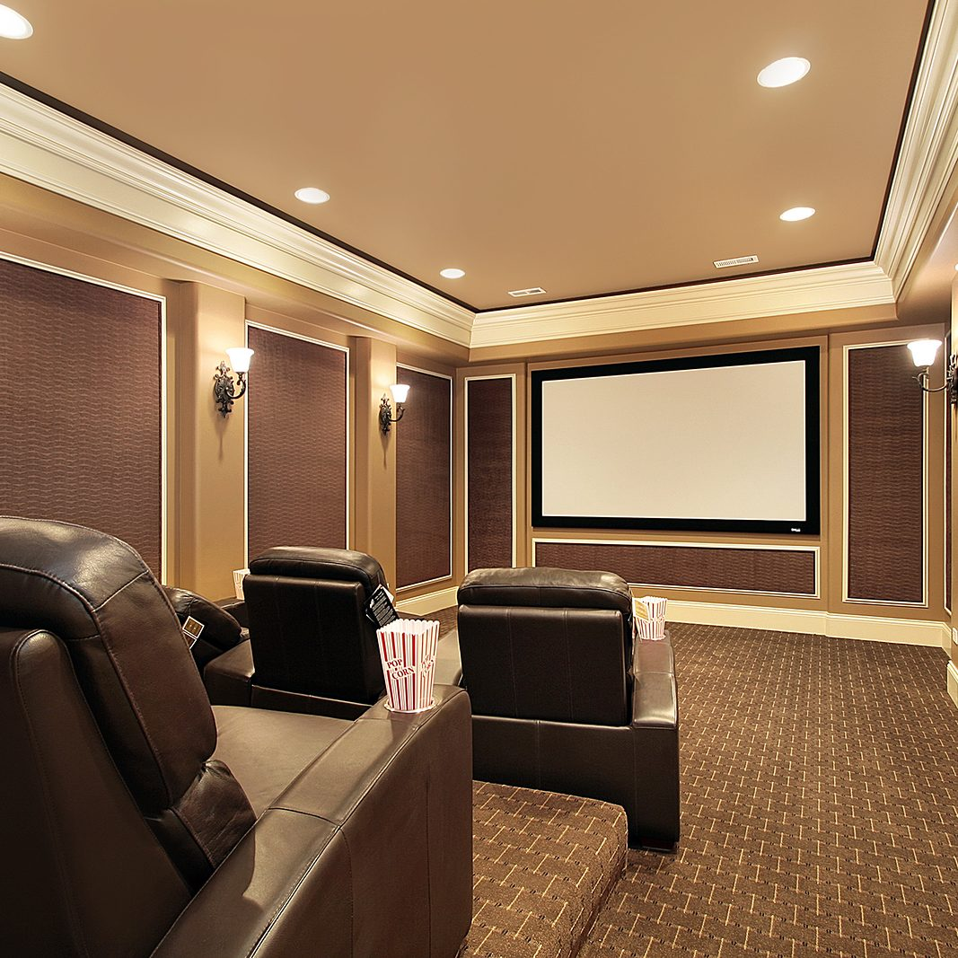 Home theater in luxury house with large TV screen