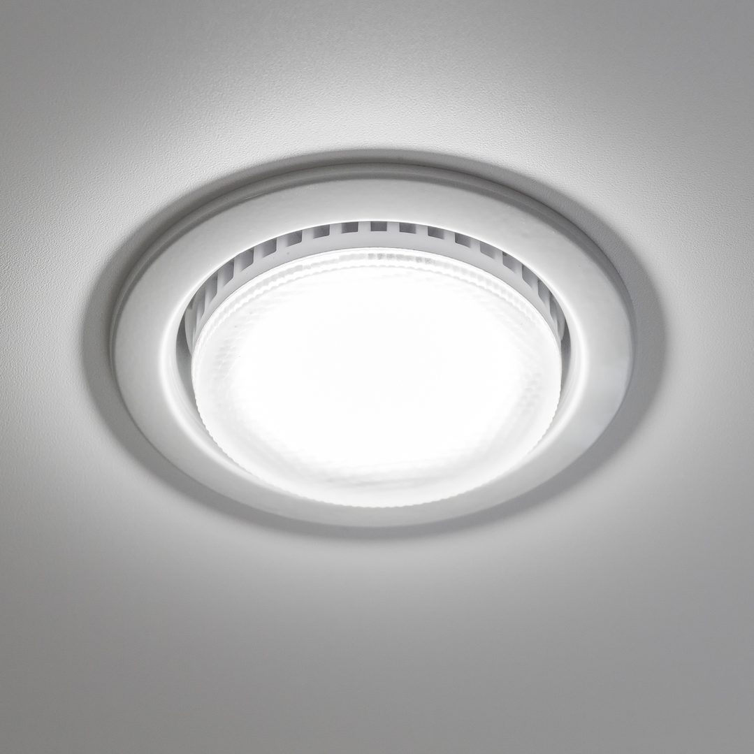 Recessed ceiling light close-up against a white ceiling