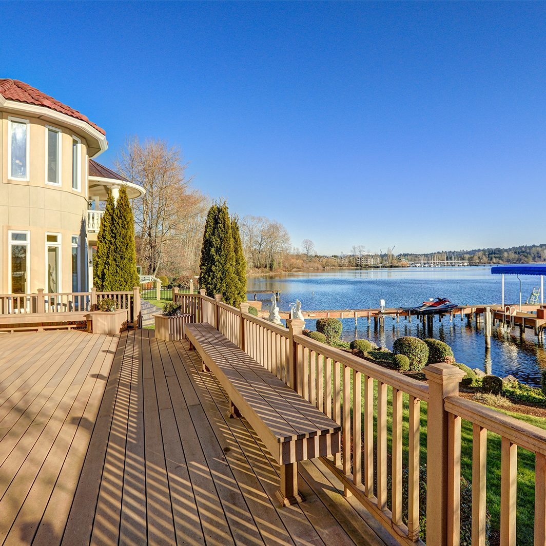 Sunny Spacious Walkout Deck Of Luxurious Waterfront Home