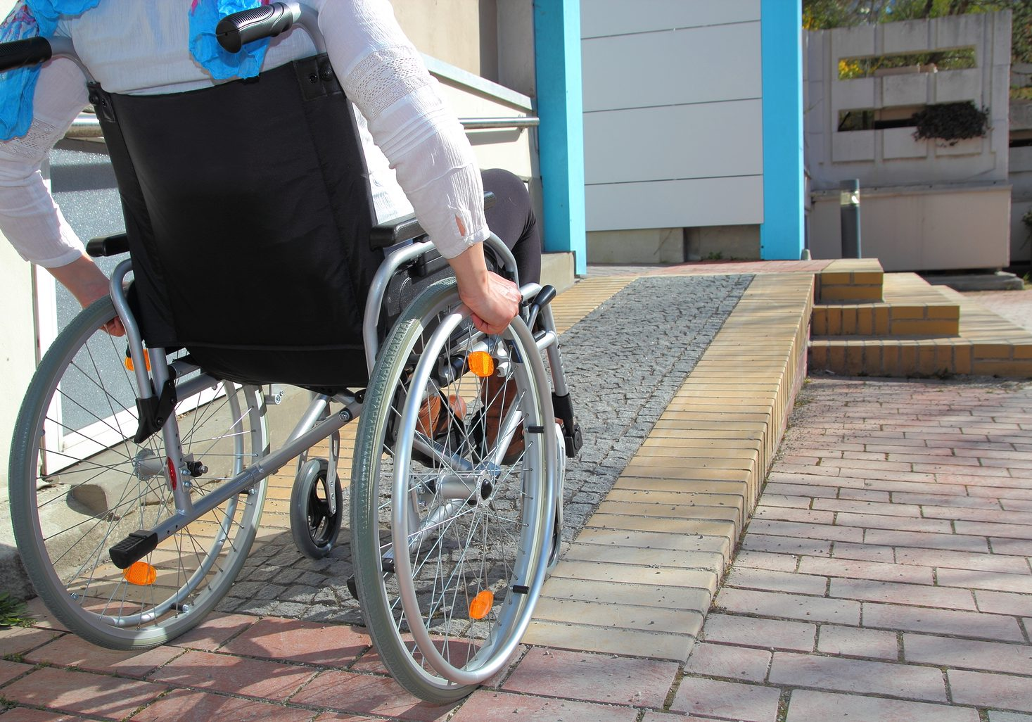 Woman in a wheelchair using a ramp